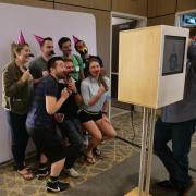 New Venture Challenge attendees pose for group photo with fun props