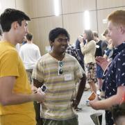 Students talk at a past NVC Kickoff Night