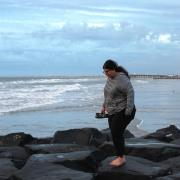Emily Nocito walking on rocks along the Ocean City shore
