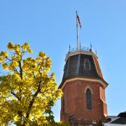 American flag flies atop of Old Main