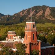 Old Main with the Flatirons in the background
