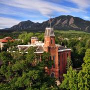 Old Main against the backdrop of the Flatirons