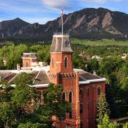 Old Main showcased against the Flatirons