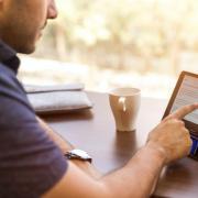 person checks social media on tablet