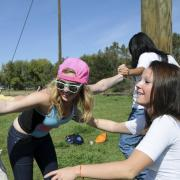 students participating in an outdoor challenge course