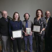 Past winners of the Anne K. Heinz Outreach Staff Award with Provost Russell Moore, far left, and Chancellor Phillip DiStefano, right