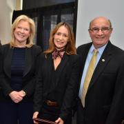 Pilar Prostko from CU Dialogues receiving the 2017 staff award from Provost Russ Moore, Vice Provost for Outreach and Engagement Sara Thompson and Chancellor Phil DiStefano.