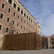 gold shipping container on the CU Boulder campus