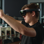 A young man appears with virtual reality glasses on.