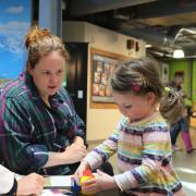 CU Boulder student Kathryn Flint, left, at the Children's Museum of Denver