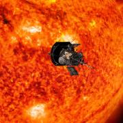 Parker Solar Probe circles in front of the sun in this artist rendering.