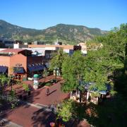 Pearl Street in Boulder with the Flatirons in the background