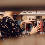 Person browsing library