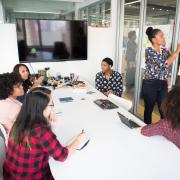 Stock image of women holding a meeting