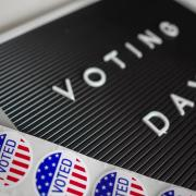 A voting day sign and stickers