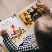 Woman reading a book to a toddler