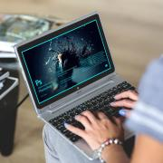 Person using Creative Cloud on a laptop