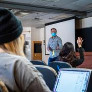 Students stay socially distanced and wear masks in Tom Zeiler's class during the first week of in-person instruction on campus in the 2021 Spring semester. (Photo by Patrick Campbell/University of Colorado)