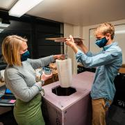Evan Kirk and Claire Meyer demonstrate how thermal testing for the PortaVax device is set up