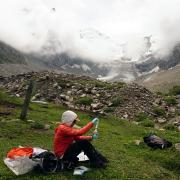 Alice Hill doing research on a mountainside