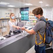 student filling a prescription on campus