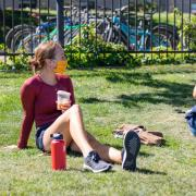 students sitting outside on campus