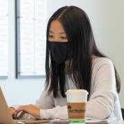Woman studying in front of a computer.