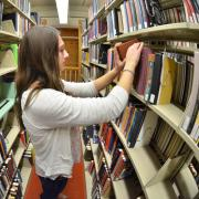 Filing books in the stacks in Norlin Library