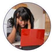 Student looking at her laptop