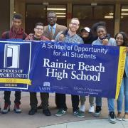 Students at Rainier Beach HS holding a recognition banner