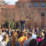 Graduate student Liz Marasco speaks at a rally on campus Wednesday, Nov. 29.