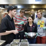 Students listen in during Ralphie's Cooking Basics