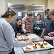 Students learn to cook chicken parmesan in Ralphie's Cooking Basics