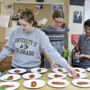 Students cooking.