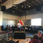 Musicians performing at Rayback Collective