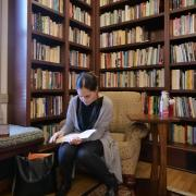 Grad student studying in reading room