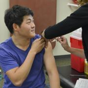 A student getting a flul shot