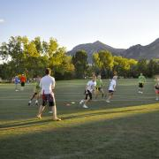 Students playing intramural football at CU Boulder