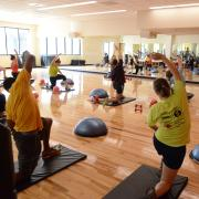 Students participate in fitness class at The Rec Center