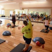 Students work out during fitness class at The Rec