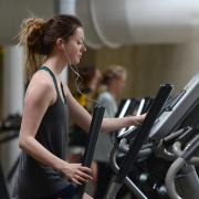 student exercises on elliptical machine