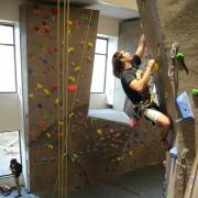 Jared Spegele picks a rout on the climbing wall at The Rec