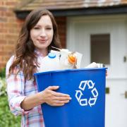 person holding recycling bin