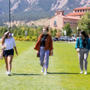 friends in masks walking on campus
