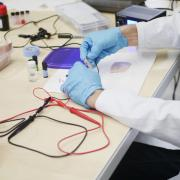 A CU Boulder researcher works on a project in a lab.