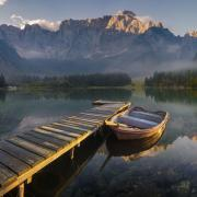 Stock image of a boat and a dock on a mountain lake