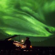 Roman Zavada performs live to lasers and footage of the Aurora Borealis in Northern Canada at Fiske Planetarium. Photo by Glenn Asakawa.