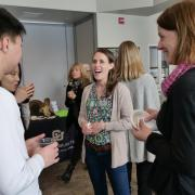 colleagues talk at research expo