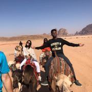 CU students riding camels in Jordan