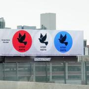 Billboard art displaying three circles with doves in them